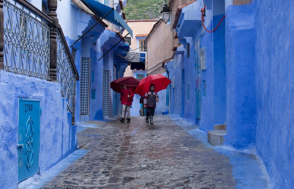 JacobusCa-Red-Umbrellas-in-a-Blue-City_1
